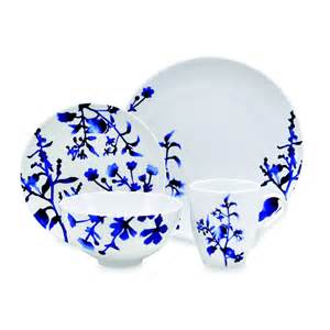 the delicate blue pattern on the white dishes
