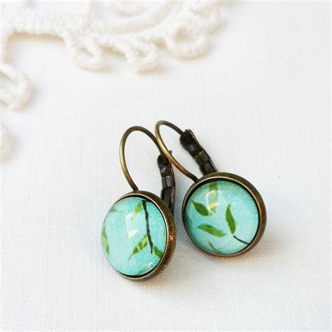 vintage style green earrings by pomegranate prints