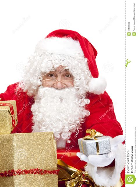 happy santa claus holding christmas gifts in hands royalty