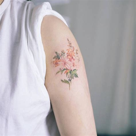 illustrative tattoo illustrative style flower on the left arm