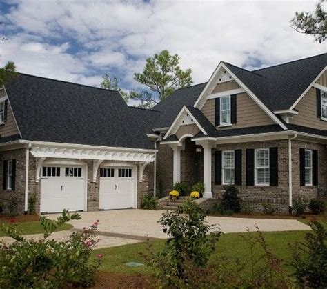 exterior colors brick and but with white trim windows garage doors with windows and