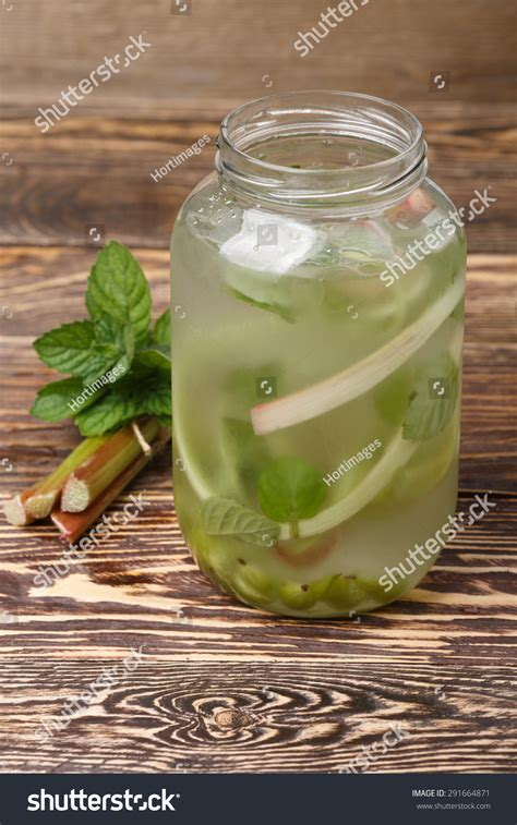 Amla Detox Water by Pitcher Rhubarb Gooseberry Mint Detox Water Stock Photo