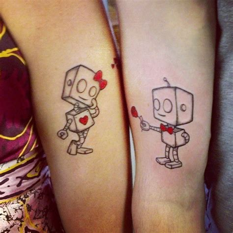 we heart it tattoo couple 15 awesome two part tattoos heart couple guff
