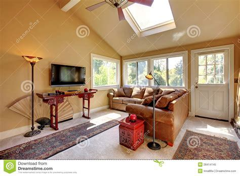 Large Living Room With Sofa, TV And Brown Walls. Royalty