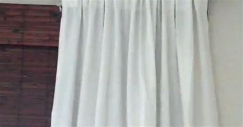 different ways to drape curtains tutorial different ways to hang curtains diy