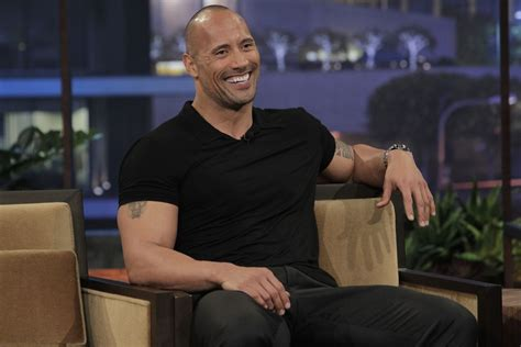 dwayne johnson tattoo date the rock just covered up his brahma bull tattoo with a way