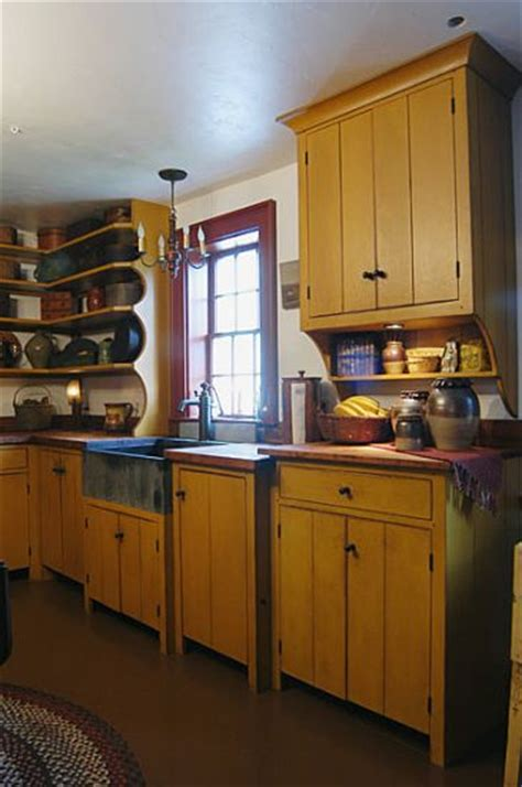 primitive kitchen designs i love all the antiques on this counter and shelf but i