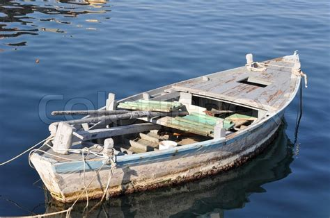 old boat equipment old wooden fisher boat tied to buoys not visible in a
