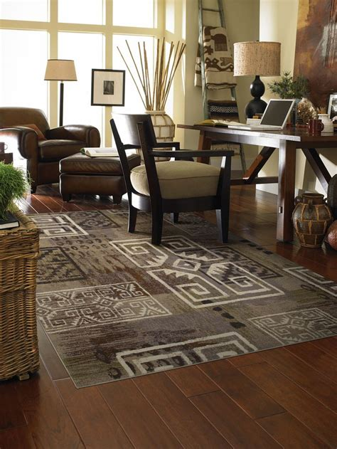 rug on hardwood floor 57 best images about area rugs on wood