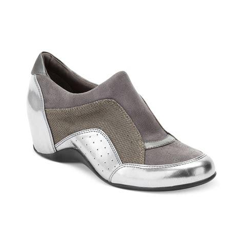 dkny wedge sneakers on sale dkny pacific wedge sneakers in gray gunmetal lyst