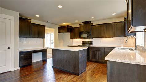 should you stain or paint your kitchen cabinets for a change in color petermann
