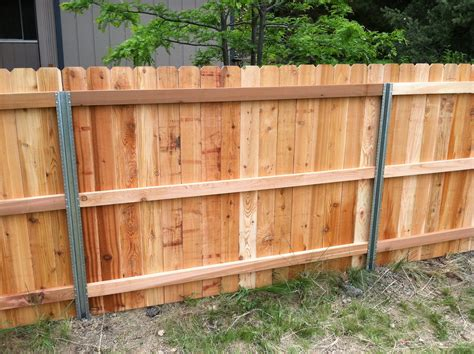 wood and metal fence steel posts postmaster with cedar privacy fence back