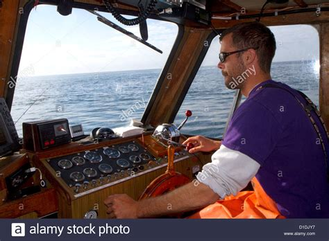 skipper fishing boat skipper on a fishing boat in the pacific ocean off the