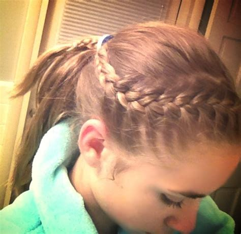 hair braidmed into pony tail with a ball a tight french braid into a ponytail great for playing