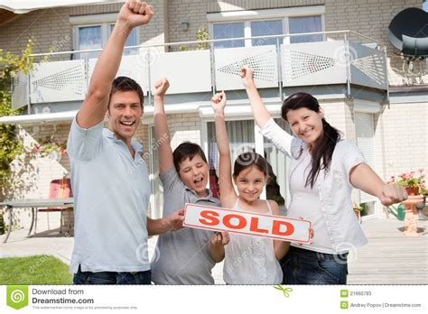 buying house from family happy family celebrating buying their new house stock