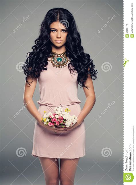 Dress Pink Curly fashion model in pink dress stock photo