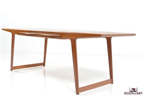 organic shaped sofa table in teak room of