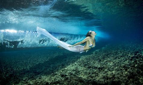 swing in the ocean a photographer has captured models swimming through the