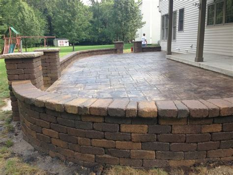 decorative sted concrete patio with retaining wall and