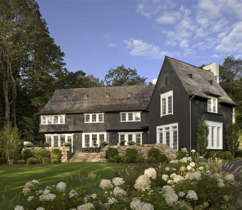 black and white home black exterior ideas for a hauntingly beautiful home
