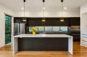Modern Kitchen Lighting by Modern Kitchen With Stone Island Bench Feature Lighting