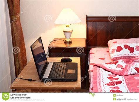 computer table in bedroom laptop on table near bed in bedroom royalty free stock