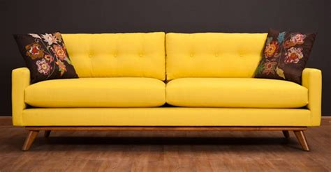 bright yellow couch yellow common areas pinterest