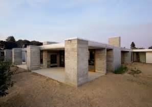 prefabricated concrete home in sonoma county ca aligned with the orchard