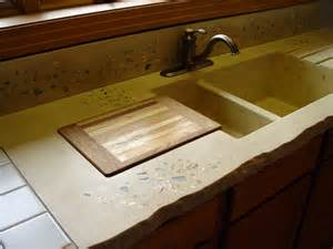 yellow concrete counter with an integrated sink