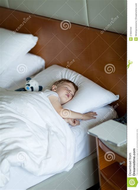 how to sleep in a room adorbale toddler sleeping in hotel room stock photo image 27903194