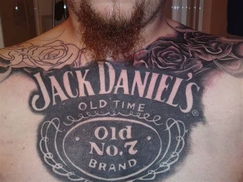 jack daniels tattoo designs bottle with word on thigh