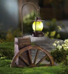 western wagon wheel with solar lighted lantern outdoor