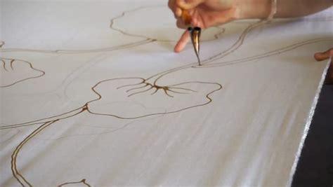 design batik canting 4k footage people working batik dyeing color process basic