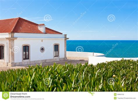 Lighthouse House Plans Turquoise Sea Blue Sky And White House In Portugal Stock