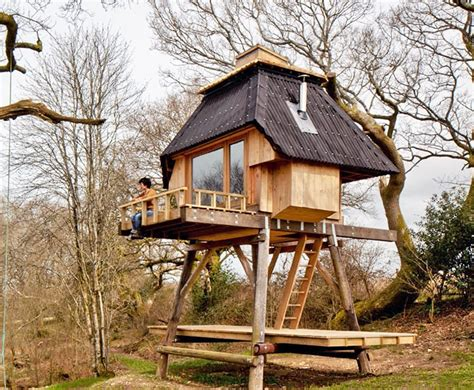 100 Tiny Houses That Make Downsizing Look Good Housely Tiny House On Stilts
