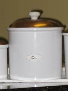 kitchen canisters white set of three ceramic white canisters w copper lids