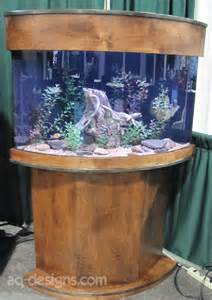 54 gallon Corner Aquarium with a custom built stand. Our first attempt