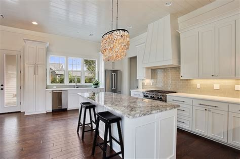 white kitchen cabinets and white countertops seashells chandelier design ideas