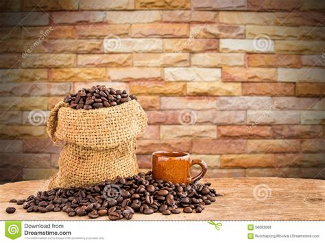 coffee sack wallpaper coffee beans in burlap sack on wooden table with blurred