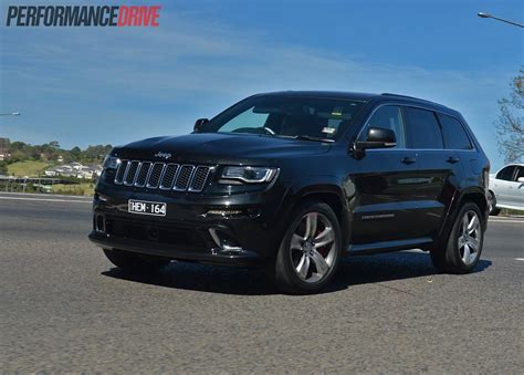 2014 blue jeep grand cherokee 2014 jeep grand cherokee srt cornering