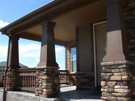 house with columns the bulky columns and stacked stones give this front porch