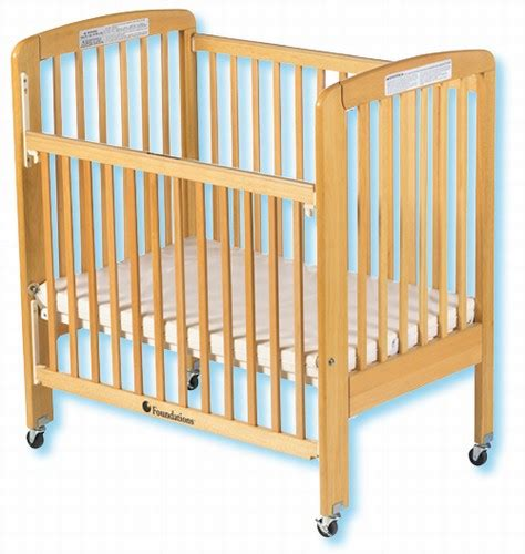 Cribs With Drop Sides by Foundations Wood Travel Sleeper Folding Drop Side