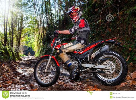 z racing motocross track motocross rider with bike in dirt track stock photo