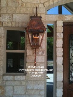 hill country style home  gas lanterns traditional