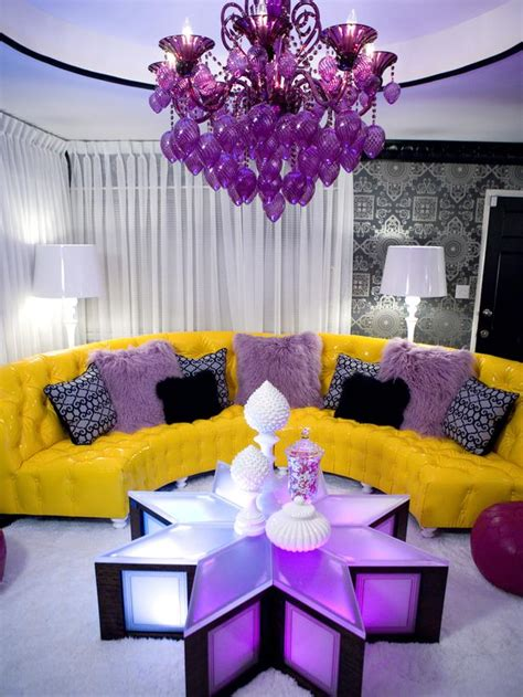 eclectic living room with purple and yellow furnishings hgtv