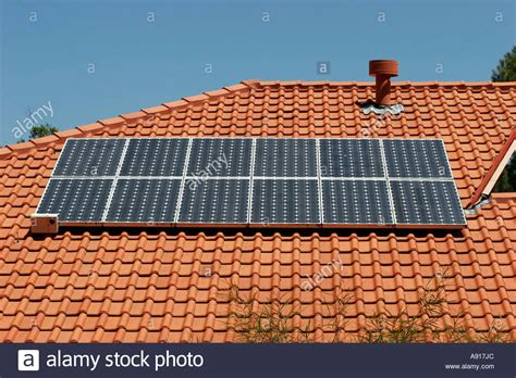 buying a house in south australia photovoltaic solar panels on a house roof in sydney new south wales stock photo