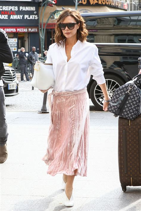 celebrity pink skirt victoria beckham s pink pleated skirt and white blouse