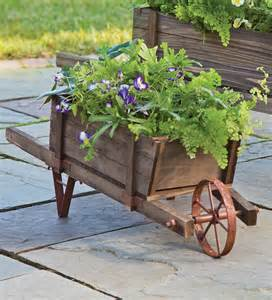 wooden wheelbarrow planter garden plow hearth