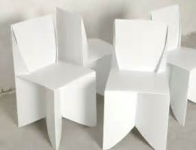 Origami style paper thin patio ready white folding chairs