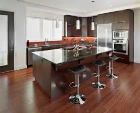 Wood cabinets island also modern bar stools and polished wood floors